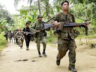 Philippine soldiers search for Abu Sayyaf extremists during a patrol of Basilan island in 2002. Philippine authorities have arrested a founding member of the Al Qaeda-linked Abu Sayyaf group that has been blamed for some of the worst terror attacks in the region