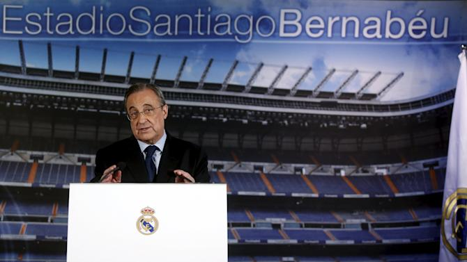 Real Madrid's President Perez gestures during a news conference at Santiago Bernabeu stadium in Madrid