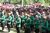 New People's Army (NPA) guerrillas attend a ceremony to celebrate the 42nd anniversary of the founding of the Communist Party of the Philippines, in a remote village on the southern island of Mindanao on December 26, 2010. A top Philippine communist rebel with a $128,000 bounty on his head was arrested on Tuesday, the military said