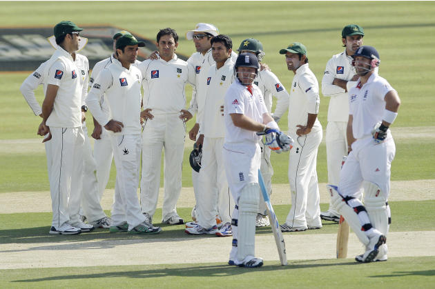 The Pakistan team members watch a replay on the big screen of Saeed Ajmal, third left with no cap, taking the wicket of England's Matt Prior, right, lbw during the third day of their second cricket te
