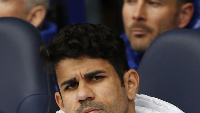 Chelsea's Diego Costa sits on the bench before the match