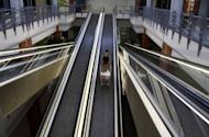 A woman stands on an escalator with her shopping trolley at a partially empty shopping mall in Nicosia on June 21. In lodging its request for rescue cash Cyprus did not specify how much it needed or whether the help was for its banks or a general government bailout