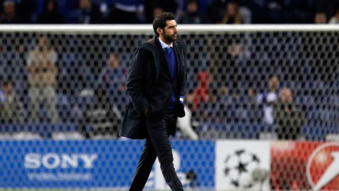 Porto's coach Paulo Fonseca leaves the pitch cheered by supporters at the end of the Champions League group G soccer match between FC Porto and Austria Vienna Tuesday, Nov. 26, 2013, at the Dragao stadium in Porto, northern Portugal. The game ended in a 1-1 draw