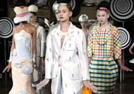The Thom Browne Spring 2013 collection is modeled during Fashion Week in New York, Monday, Sept. 10, 2012. (AP Photo/John Minchillo)