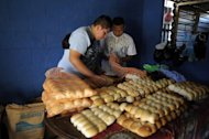 Members of the Barrio 18 gang put bread into bags at a bakery they operate in Ilopango, El Salvador on January 21, 2012. Around 20 members of the gang have opened a bakery hoping to put their violent past behind them and become ordinary citizens