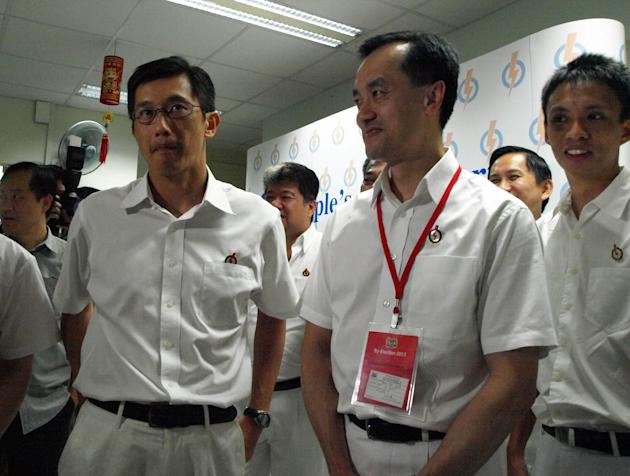 PAP's Dr Koh with Teo Ser Luck, MP for Pasir-Ris Punggol, at the PAP branch in Punggol East.