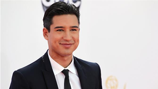 "FILE - In this Sept. 23, 2012 file photo, Mario Lopez arrives at the 64th Primetime Emmy Awards at the Nokia Theatre, in Los Angeles.  Fox's ""The X Factor"" began airing live episodes Wednesday, Oct. 31, 2012, with new co-hosts Khloe Kardashian and Mario Lopez. (Photo by Matt Sayles/Invision/AP, File)"