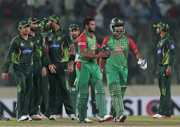 Bangladesh's Tamim Iqbal, second right, and Shakib Al Hasan, third right, walk back after winning the second one-day international cricket match against Pakistan in Dhaka, Bangladesh, Sunday, April 19