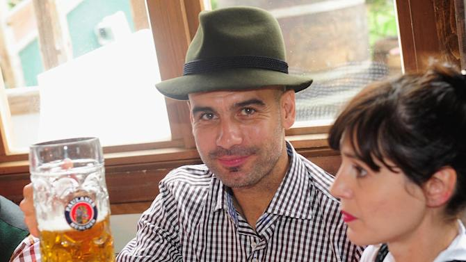 Pep Guardiola, head coach of Bayern Munich and his wife Cristina Guardiola, from left, attend the Oktoberfest beer festival in Munich southern Germany, Sunday, Oct 6, 2013
