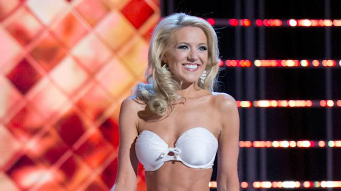 This photo courtesy Miss America Organization shows Miss Washington Mandy Schendel who took the trophy for the third round of the Lifestyle and Fitness category after modeling a strapless white Catalina swimsuit on Thursday. Jan. 10, 2013, at the Planet Hollywood casino in Las Vegas. The 22-year-old from Newcastle, Wash., earned a $1,000 Amway scholarship for it.  (AP Photo/Miss America Organization)