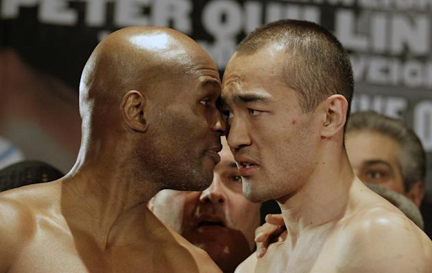IBF light heavyweight boxing champion Bernard Hopkins, left, faces off with WBA and IBA light heavyweight boxing champion Beibut Shumenov, of Kazakhstan,after a weigh-in Friday, April 18, 2014, in Was