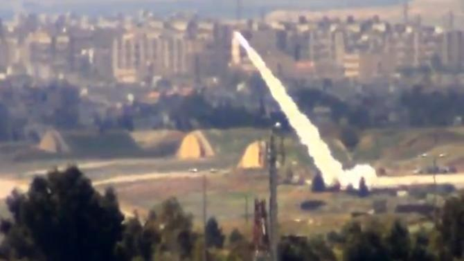 In this image taken from video obtained from the Shaam News Network, which has been authenticated based on its contents and other AP reporting, and released Monday March 18, 2013, Syrian government forces fire rockets toward residential neighborhoods, in Damascus, Syria. Two years after the anti-Assad uprising began, the conflict has become a civil war, with hundreds of rebel group fighting Assad's forces across Syria and millions of people pushed from their homes by the violence. The U.N. says more than 70,000 people have been killed. (AP Photo/Shaam News Network via AP video)