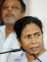West Bengal's chief minister Mamata Banerjee addresses a press conference in Kolkata on September 19. Banerjee announced that her Trinamool Congress was quitting the coalition government