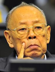 In this photo released by the Extraordinary Chambers in the Courts of Cambodia, Ieng Sary, Khmer Rouge's former foreign minister, touches his face during the second trial of the top leaders of Khmer Rouge in the court hall of the U.N.-backed war crimes tribunal on the outskirts of Phnom Penh, Cambodia, Thursday, June 30, 2011. The tribunal on Thursday held its fourth day trial on top four surviving members of the Khmer Rouge regime, blamed for the deaths of an estimated 1.7 million Cambodians in the 1970s. (AP Photo/Extraordinary Chambers in the Courts of Cambodia, Mark Peters) EDITORIAL USE ONLY