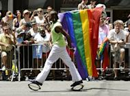 A marcher walks down 5th Avenue during the 2012 New York Gay Pride parade on June 24. The Pentagon will allow uniformed military personnel to march in a gay pride parade this weekend, reflecting the tectonic shift in an institution that long banned openly gay service members