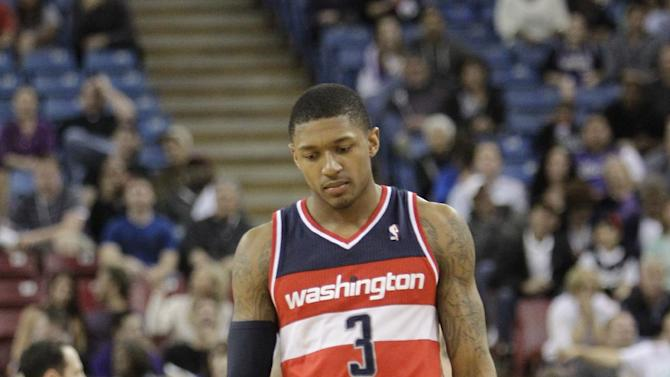 Washington Wizards guard Bradley Beal walks down court during the closing moments of the Wizards 117-111 overtime loss to the Sacramento Kings in a NBA basketball game in Sacramento, Calif., Tuesday, March 18, 2014