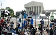 """Reporters await a decision by the US Supreme Court on the constitutionality of the Affordable Healthcare Act, US President Barack Obama's signature healthcare legislation, outside the Supreme Court in Washington, DC, June 28. Obama claimed a """"victory"""" for all Americans after the Supreme Court upheld his reforms to extend health insurance to another 32 million citizens"""