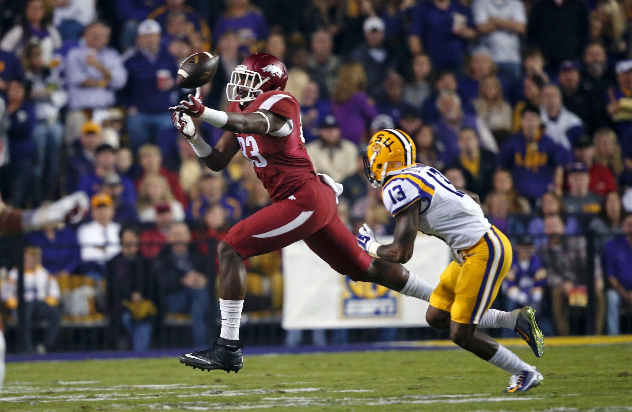 Arkansas TE Jeremy Sprinkle, left, has had to face his shoplifting incident head on. (AP)