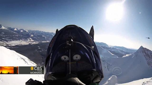 BASE jumper rides snowmobile off cliff to honor dead friend