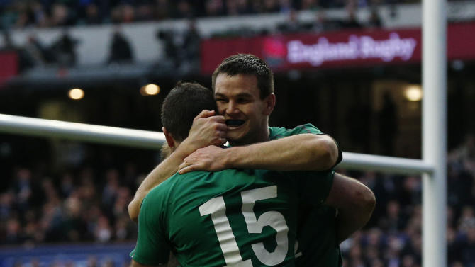 Ireland's Rob Kearney (left) celebrates scoring a try with teammate Jonathan Sexton (right) during the Six Nations Rugby Union International match between England and Ireland at Twickenham Stadium, in west London, Saturday Feb. 22, 2014. (AP Photo / Jonathan Brady /PA) UNITED KINGDOM OUT
