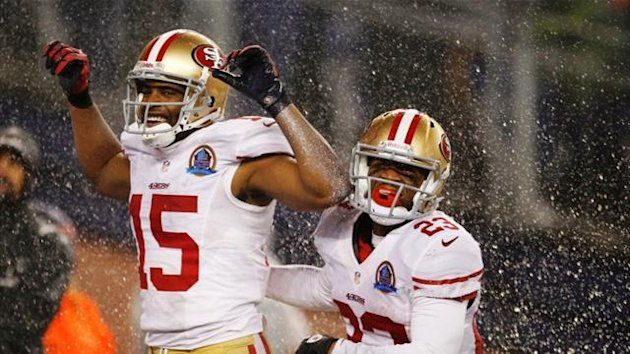 San Francisco 49ers' Michael Crabtree celebrates his touchdown against the New England Patriots with team-mate LaMichael James (Reuters)
