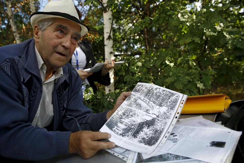 Slowikowski, retired miner and explorer shows documents near an area where a Nazi train is believed to be at, in Walbrzych