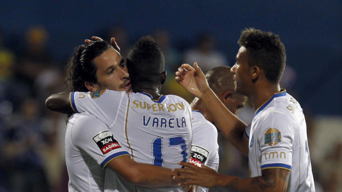 "Porto's Luis ""Lica"" Carneiro, left, celebrates with teammates Silvestre Varela, center, and Danilo Silva, from Brazil, after scoring the opening goal against Estoril during their Portuguese league soccer match at the Antonio Coimbra da Mota stadium in Estoril, near Lisbon, Sunday, Sept. 22, 2013"