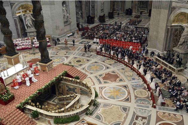 Pope Francis officiates a mass at the wedding of 20 couples in St.Peter's Basilica at the Vatican