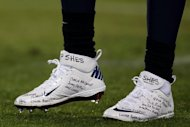 Tennessee Titans player Chris Johnson paid tribute to the victims of Newtown by wearing shoes with the names of the children and their teachers written on them on December 17, 2012. But US professional athletes have been known to take guns on team flights, carry them in their cars and even sneak them into their teams' dressing rooms