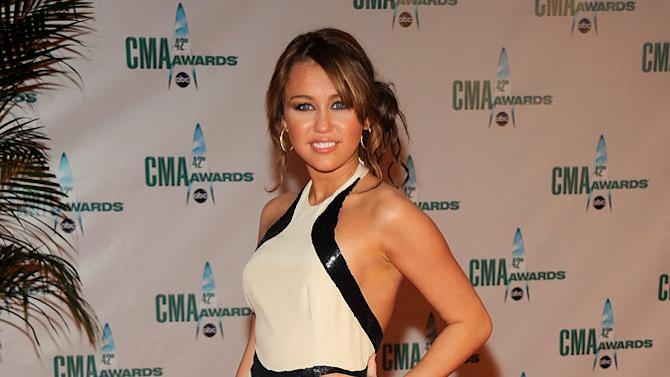 Actress, singer Miley Cyrus attends the 42nd Annual CMA Awards at the Sommet Center on November 12, 2008 in Nashville, Tennessee.