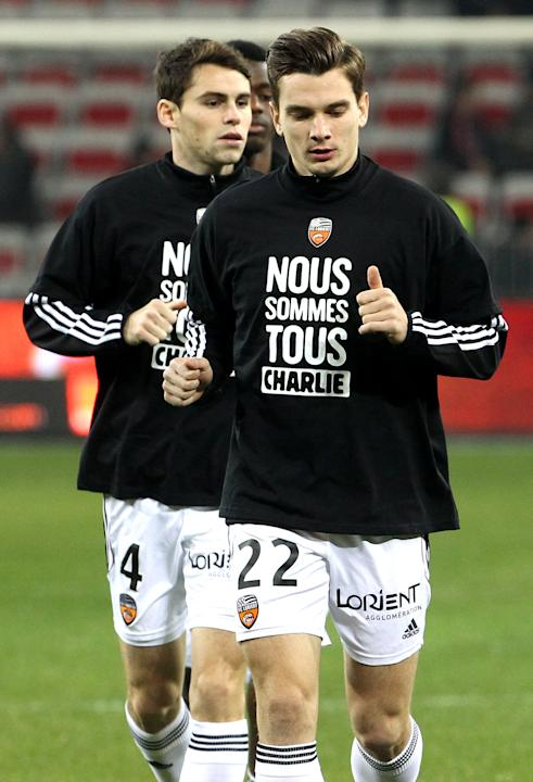"Lorient's Benjamin Jeannot wears a T-shirt reading ""We are all Charlie"" for victims of the shooting at the satirical newspaper Charlie Hebdo, Saturday, Jan. 10, 2015, in Nice stadium, southeastern Fra"