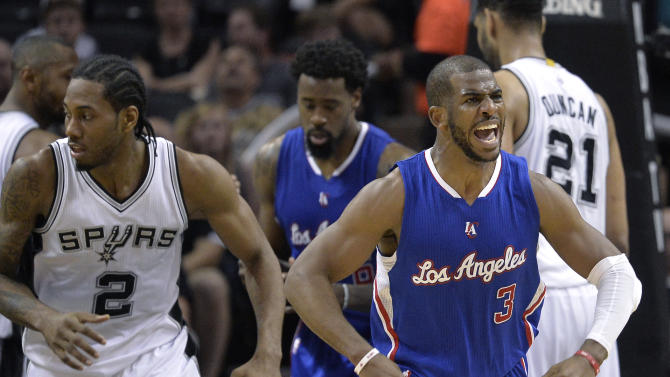 Los Angeles Clippers' Chris Paul (3) celebrates after scoring against the San Antonio Spurs during the second half of Game 4 in an NBA basketball first-round playoff series, Sunday, April 26, 2015, in San Antonio. (AP Photo/Darren Abate)