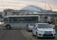 Russian police officers sit on a bus at an access road near venues at the Olympic Park near Sochi January 7, 2014. REUTERS/Kazbek Basayev