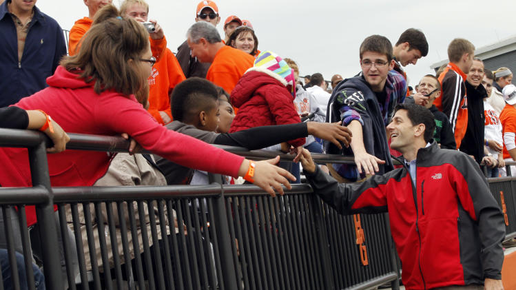 Republican vice presidential candidate, Rep. Paul Ryan, R-Wis., greets spectators at the Bowling Green State University and Miami University of Ohio football game, Saturday, Oct. 13, 2012 in Bowling Green, Ohio. (AP Photo/Mary Altaffer)