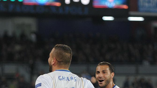 Porto's Nabil Ghilas, left, celebrates with teammate Ricardo Quaresma after scoring during an Europa League, round of 16 return-leg soccer match against Napoli at the Naples San Paolo stadium, Italy, Thursday, March 20, 2014