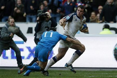 France's Louis Picamoles fights for the ball with Italy's Leonardo Sarto as he runs to score a try during their Six Nations rugby union match at the Stade de France in Saint-Denis
