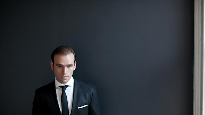 "This 2012 portrait provided by Arielle Doneson shows tenor Michael Fabiano in New York. On Monday, April 8, 2013, Fabiano will make his highest-profile New York appearance yet, singing the role of Oronte in Verdi's ""I Lombardi"" in concert with the Opera Orchestra of New York at Lincoln Center's Avery Fisher Hall. Fabiano will be rememberd by music lovers who have seen ""The Audition,"" the documentary about a vocal competition at the Metropolitan Opera, as the dark, almost brooding presence who stands out in sharp contrast to his chipper, smiling fellow contestants. (AP Photo/Arielle Doneson)"