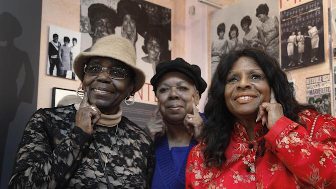 "This March 12, 2013 photo show The Andantes, from left, Jackie Hicks, Marlene Barrow-Tate and Louvain Demps posing during a visit to Motown Historical Museum in Detroit. In their 70s, the unsung backing group who sang on thousands of Motown songs is finally getting acclaim for its contributions to the ground-breaking, chart-topping music made in Detroit in the 1960s and early '70s before the label moved to Los Angeles. The trio gathered recently to see the exhibit, ""Motown Girl Groups: The Grit, the Glamour, the Glory.""  The Andantes are featured, with equal billing, alongside the Supremes, Vandellas, Marvelettes and Velvelettes. (AP Photo/Paul Sancya)"