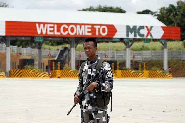 Soldier stands guard during the opening of MCX Tollway, a new expressway in Muntinlupa