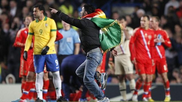 A pitch invader runs on the pitch during the international friendly between Brazil and Russia at Stamford Bridge (AFP)
