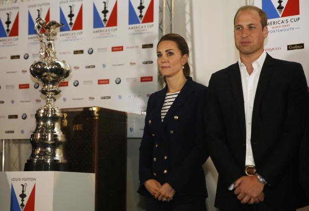 Britain's Prince William and his wife Catherine, Duchess of Cambridge, stand by the America's Cup at the close of the British leg of the Amercia's Cup World Series in Portsmouth