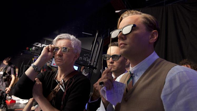 "This film publicity image released by Warner Bros. Pictures shows director Baz Luhrmann, left, with actors Tobey Maguire, and Leonardo DiCaprio in a scene from ""The Great Gatsby."" (AP Photo/Warner Bros. Pictures, Douglas Kirkland)"