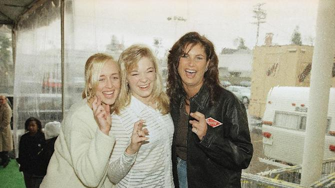 FILE - In this Jan. 26, 1997 file photo, country music singers Mindy McCready, left, LeAnn Rimes and Terri Clark joke around after a rehearsal for the American Music Awards at the Shrine Auditorium in Los Angeles. McCready, who hit the top of the country charts before personal problems sidetracked her career, died Sunday, Feb. 17, 2013. She was 37. (AP Photo/Michael Caulfield, File)