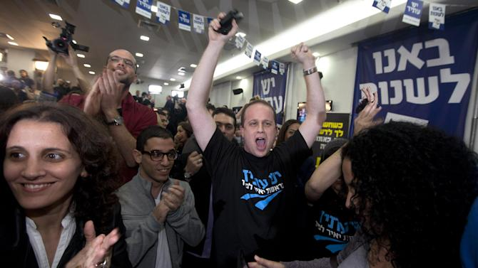 "Supporters of Yair Lapid and his ""Yesh Atid"" party celebrate election results in Tel Aviv, Tuesday, Jan. 22, 2013.  The party, formed just over a year ago, out did forecasts by far and are predicted to capture as many as 19 seats, becoming parliament's second-largest party, after Netanyahu's Likud-Beiteinu bloc, which won 31, according to the exit polls. (AP Photo/Sebastian Scheiner)"