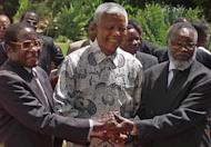 The three presidents of South Africa, Nelson Mandela, Zimbabwe's Robert Mugabe and Namibia's Sam Nujoma in Pretoria, 05 March 1999. Mugabe criticises Nelson Mandela for being too soft on whites, in a documentary giving a rare and intimate look into the family life of one of Africa's longest serving and most vilified leaders