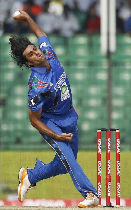 Afghanistan's Zadran bowls against Pakistan during their Asia Cup 2014 ODI cricket match in Fatullah