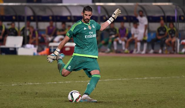 Real Madrid goalkeeper Kiko Casilla scores a goal during the penalty shootout of the International Champions Cup football match between AC Milan and Real Madrid in Shanghai on July 30, 2015
