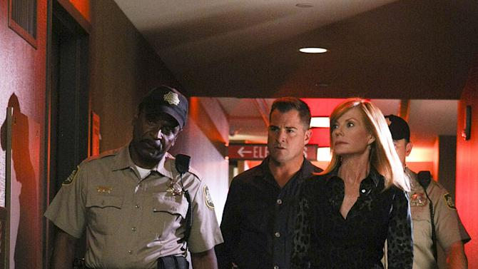 """George Eads, center, as Nick Stokes and Marg Helgenberger as Catherine Willows on """"CSI: Crime Scene Investigation."""""""