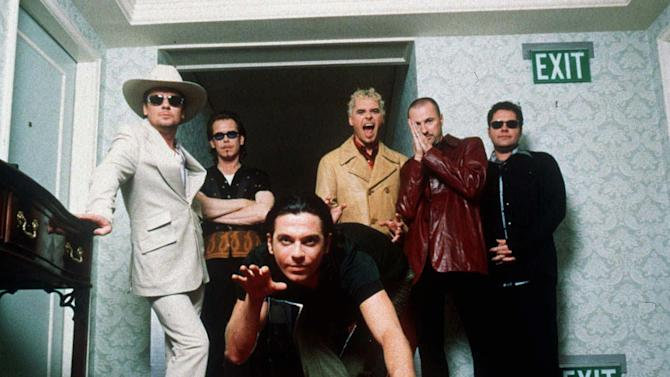 FILE - in this 1997 file photo,  members of the Australian rock band INXS pose for a group portrait at the Ritz Carleton Hotel in Aspen. Colo. They are, from left, Tim Farriss, Kirk Pengilly, Michael Hutchence, foreground, Jon Farriss, Garry Gary Beers and Andrew Farriss. Drummer Farriss announced the end of the band's remarkable run of performances during a concert in the West Australia city of Perth earlier in the week of Nov. 11, 2102. The band later confirmed the news in a statement. (AP Photo/James Minchin, File)