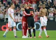 "Bayern midfielder Bastian Schweinsteiger (2nd L) embraces teammate and Dutch midfielder Arjen Robben after the friendly between Bayern and the Netherlands in Munich, southern Germany, on May 22. Netherlands coach Bert van Marwijk has strongly criticised the ""scandalous"" treatment of Robben during the Oranje's friendly against his club Bayern"